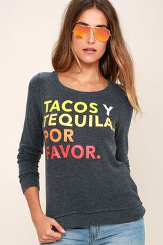 "You can't have tacos without tequila, and you can't have a good time without the Chaser Tacos Y Tequila Washed Blue Sweatshirt! Soft and fuzzy fleece knit shapes a crew neckline and relaxed bodice with ""Tacos Y Tequila. Por Favor."" in yellow, orange, and red across the front. Banded long sleeves and hem with back-stitched detail."