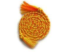 Sunshine jump rope made with 100% orange and yellow acrylic yarn. Length is approximately 7' and is great for adults and children.