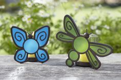These cute Flutter Bugs are perfect in the garden! The stained glass glows when lit giving a beautiful glow day or night.