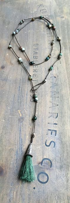 Lariat strung on dark brown leather with tassel and amazonite beads. Can be worn as wrap bracelet as well