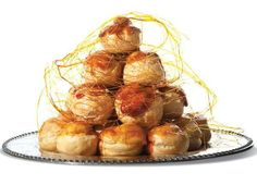 Croquembouche, a spire of caramelized cream puffs are a popular dessert at French weddings, made from extremely versatile pate a choux, filled with cream and dressed in a web of that delicious amber glaze.