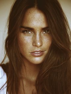 I seriously think this girl is gorgeous...love her freckles!