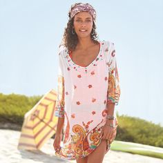 """PAISLEY PLAYGROUND COVER-UP--Over jeans, shorts or your swimsuit, this breeze-weight cotton cover-up is the coolest, printed with paisleys and scattered with sequins 'round the neck. Machine wash. Imported. Sizes S (2), M (4 to 6), L (8 to 10). Approx. 36""""L."""
