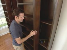 HOW TO CREATE A SLIDING WALL OF STORAGE...this would be great as a door for the bedroom closet, it would add a ton of extra storage space
