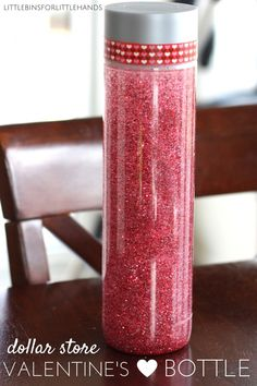 Easy to make glitter glue Valentine's Day sensory bottle using dollar store glue, glitter, and tape. Simple and fun Valentine's Day activity kids can make. Great for all ages, preschool, kindergarten, grade school, and even teens and adults can use this relaxing and calming sensory bottle. Sensory bottles are often referred to as calm down jars or bottles because of their ability reduce anxiety. I love the glitter bottle for sensory play.