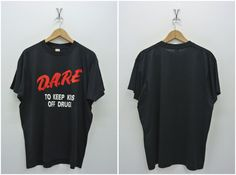 Up for sale is a pre owned vintage 80s DARE t shirt. 50% cotton, 50% polyester. Made in USA. Good used condition. 7/10. A few defects. Minor faded spot. Please enlarge the photos to get clear image. Measurement taken while laying flat.  Pit to pit - 23 inches Shoulder to shoulder - 20 1/4 inches Length - 26 3/4 inches Sleeve length from shoulder - 6 3/4 inches  Please compare the measurement with your garment. Kindly read my shipping and policies. Shipping may takes 14 to 30 days depends on…