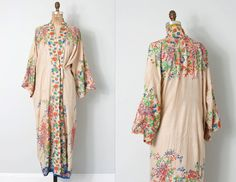 vintage 1920s Japanese floral silk kimono robe. lightweight ecru raw silk with bright screen printed Japanese floral motifs in gorgeous blues, greens and orange. loose fitting robe has silk tie closures, ever so slightly sheer. a stunning and chic choice for summer lounging! L A B E L  tiny made in Japan tag         |      |     |     |     |   make sure to measure   |     |     |     |      M E A S U R E M E N T S  bust 49  waist 49 length 49  across back 25.5    one size fits most. C O N D…