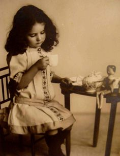 A little girl and her wooden doll c.1905
