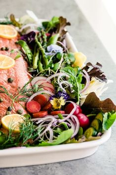 Spring Salmon Salad Platter for Easter, Passover, Mother's Day, or your best friend's shower ~ a healthy side of wild salmon over pretty spring greens! #easy #recipe #salmon #side #wildsalmon #fish #easter #passover #mothersday #spring #edibleflowers #pansies #salad #dinner #meatless #healty #omega3 #hearthealthy #maincoursesalad #brunch