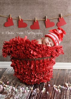 Paper #hearts on a clothesline as backdrop for a #Valentine #baby photoshoot #Artsandcrafts