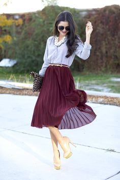 Have some fun with your striped button-up shirt. Add a cluster of pearls, a leopard clutch and a midi skirt!