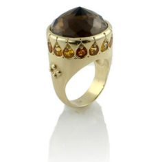 A Timeless Gold Holiday Gift! 14K GOLD MOOR RING WITH SMOKEY QUARTZ: The Moor ring setting is one to behold, so ancient and bold. Created in 14k yellow gold, the large center smoky quartz gem has been set upside down for drama and intrigue. The sides of the ring are adorned with small carvings where yellow citrines have been set.