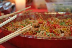 Yu Sheng Salad - this seasonal noodle salad is enjoyed in Singapore for Chinese New Year.  Everyone digs in with their pair of chop sticks and it's shared!  Yum!  During the holiday season you can find this in any grocery store in Singapore.