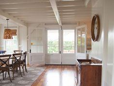 Dining room of seaside cottage, Mandala rug by Madeline Weinrib | Remodelista