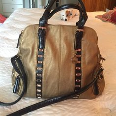 Big Budda gold large purse Great bag. Has three compartments that zip and the the purse snaps. Two outside zip pockets one at each end of purse. Shoulder strap and hand. Big Buddha Bags Shoulder Bags