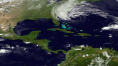 In this image taken by NOAA's GOES East on Sunday, Oct. 28, 2012, Hurricane Sandy is seen on the East Coast of the United States. Sandy weakened briefly to a tropical storm Saturday but was soon back up to Category 1 strength, packing 75 mph winds.