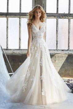 Mori Lee Bridal Kennedy 8206 is a Slim A-Line Wedding Dress Featuring an Elaborately Beaded and Embroidered V-Neck Bodice with Appliqués on English Net. Find Affordable and Exceptional Mori Lee Wedding Dresses at Ginnys Bridal Collection. Wedding Dinner Dress, Wedding Dress Trends, Perfect Wedding Dress, Bridal Wedding Dresses, Dream Wedding Dresses, Wedding Bride, Wedding Ceremony, Bridesmaid Dresses, Princess Wedding