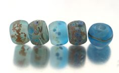 Big hole beads in watery shades of blue and green