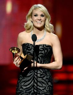 Carrie Underwood accepts the Best Country Solo Performance GRAMMY on the 55th Annual GRAMMY Awards
