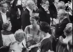 Lady Cynthia Poltimore, wife of 4th Baron Poltimore, wearing the family tiara before it went to auction in 1959. Image courtesy of British Pathe News