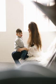 Gorgeous mother with her kids in a Seattle natural light Photography studio by Chelsea Macor Photography. The photographs are heartfelt, soulful, and authentic. #Seattlefamilyphotographer #seattlestudiophotographer