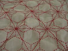 red Sashiko - I would love to do this - on squares between red prints..... Could do in any color and it would be so wonderful!