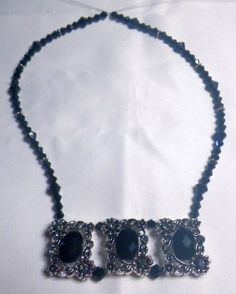 Black & Antique Silver Slider Necklace, has matching earrings.