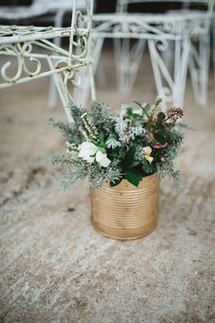 Gold tin can with spring flowers for aisle decorations // Rainy romantic wedding shoot // Box and Cox Vintage Hire // The Natural Wedding Company