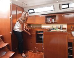 Beneteau Oceanis 41: The L-shaped galley has a gimbaled oven with two burner stove top, a fridge and a double sink. The cabinet wood and bulkheads are made of Alpi Mahogany.