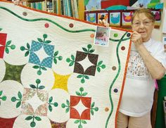 Marian holds up the a photo with #alexanderson and this very quilt, when she saw her speak locally a while back. Really great work!