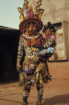 "Africa | ""Odogo"" ~ Ancient Mother and child masqueraders.  Uzairue peoples, Jattu, Nigeria. 
