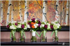 Purple, white, and orange bouquets at a wedding at the Sheraton Resort in Steamboat Springs, Colorado. - April O'Hare Photography http://www.apriloharephotography.com