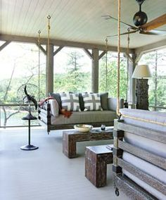 love the pillows in the swing - perfect for a beach house porch!