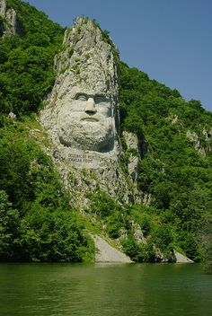 King's Decebal face carved in rock on the shores of Danube River, Romania