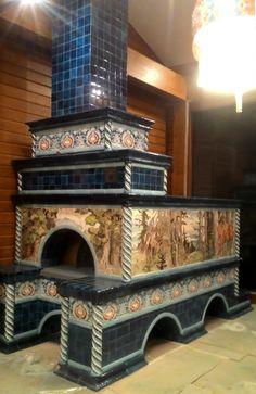 Русская печь с лежанкой, облицованная изразцами и керамическими панно по мотивам картин Ивана Билибина