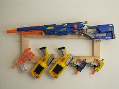 DIY Nerf gun rack- used a ladder from an old bunk bed. Used ...
