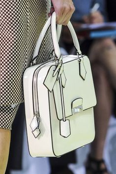 Louis Vuitton ss 2013.  I don't usually go crazy for designer bags and so on, but there's something about this one.  Maybe it's the nod to mod?