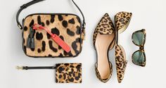 J.Crew women's Signet bag, customizable bag tag, coin purse, Sadie loafer flats in leopard and Betty sunglasses. To pre-order, call 800 261 7422 or email verypersonalstylist@jcrew.com.