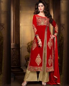 Red embroidered long suit with front slit   1. Red embroidered velvet suit 2. Golden embroidered patch yoke and sleeves3. Golden embroidered patch with front slit4. Comes with matching bottom and dupatta5. Can be stitched upto size 42 inches