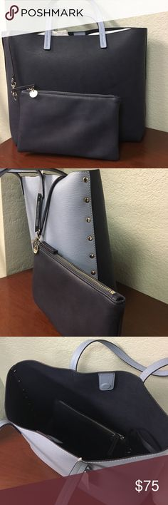 """Chelsea28 Faux Leather Tote Navy blue on one side/ Cornflower blue on the other, Faux leather tote with studs on the side. Removable zip-top Pouch inside. Magnetic snap closure. Measures 13"""" Tall x 17"""" Wide. BRAND NEW! Absolutely stunning! Chelsea28 Bags Totes"""