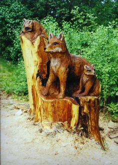 Carving of Fox with pups