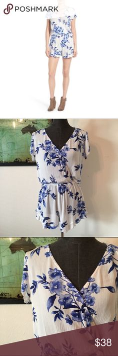 """NWOT Mimi Chica Floral Print Pocket Romper d e s c r i p t i o n  Cute cap sleeves frame a floral-print romper styled with a surplice front, handy pockets, and sweet ruffled hems. NWOT. NO TRADES.  c o n t e n t  100% rayon  m e a s u r e m e n t s ✂️  size + s   bust + 17.5""""   length + 29.5""""  size + xs   bust + 16.5""""   length + 29""""   p a i r e  w i t h 🌙  + Giani Bini wedges 💵 bundle for a discount Mimi Chica Tops"""