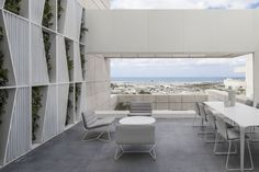 White metal panels imprinted with a geometric pattern line the walls of this penthouse apartment in Tel Aviv by Israeli studio Pitsou Kedem Architects. White Apartment, Penthouse Apartment, Interior Architecture, Interior And Exterior, Interior Design, Minimalist Interior, Contemporary Interior, Architecture Details, Landscape Architecture