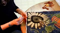 This video shows how to finish a hand hooked rug by binding it with wool fabric strips.