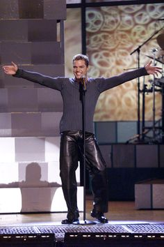 Ricky Martin dancing around in a ribbed Gap sweater and leather pants.