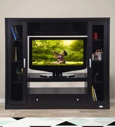 ROYALOAK assures international standard of quality & excellence. With our decades of experience and expertise we are proud to bring you the biggest collection of furniture in the country - like sofas, living room furniture, Office Furniture, Bedroom Furniture, Utility Furniture, and Outdoor Furniture in unbeatable quality, ultimate comfort and admiration with honest pricing policy. TV unit design will uplift the ambiance of the living room while taking care of the display and storage… Tv Unit Furniture, Office Furniture, Living Room Furniture, Outdoor Furniture, Wall Mounted Tv Unit, Buy Tv, Units Online, Tv Unit Design, Storage Facility
