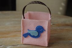 Handmade felt party favor bags, available in a variety of colors and themes