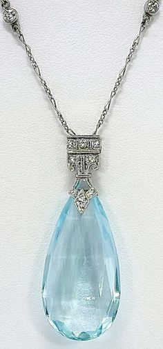 Art Deco 'Black Star & Frost' Aquamarine, Diamond, and Sapphire Necklace  This amazing natural aquamarine pendant is comprised of a checkerboard briolette cut aquamarine, which is suspended from a...