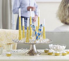 Glitzy but simple...sparkly noisemakers on a cake stand...gold and silver and blue.....New Years