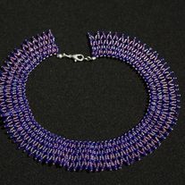 Purple netted Choker, makes a great addition to any wardrobe. Choker measures 15 inches.